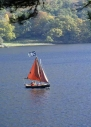 Family in sailing dinghy on lake